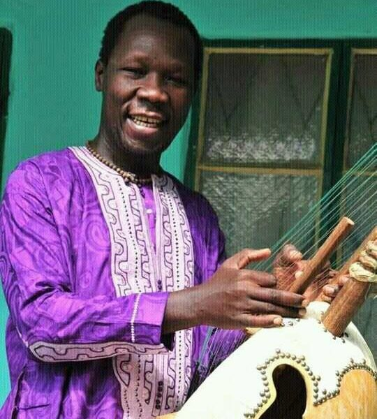 Pa Bobo playing kora in Brikama, The Gambia