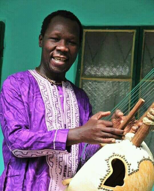 Pa Bobo playing kora in Brikama, The Gambia