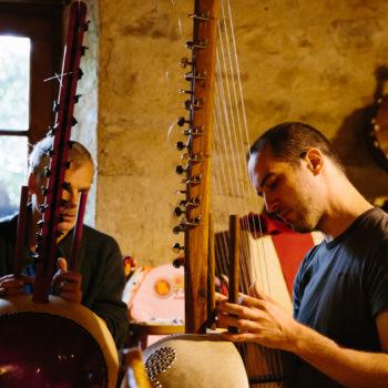 adam teaching kora student
