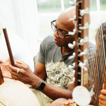 A man playing during a kora during a workshop at WOMAD