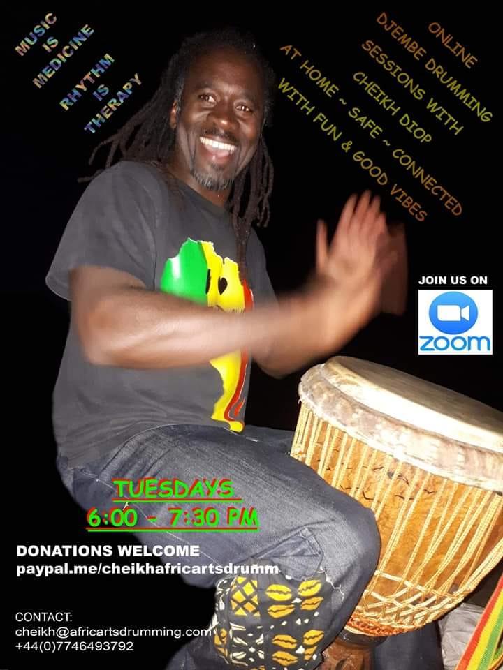 Cheikh Diop drumming