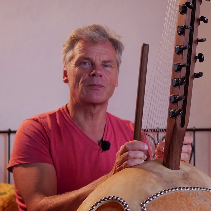 Adam playing the kora